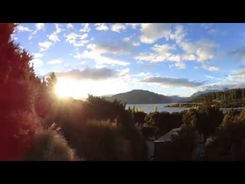 Sunset time-lapse lake outlet Wanaka, New Zealand