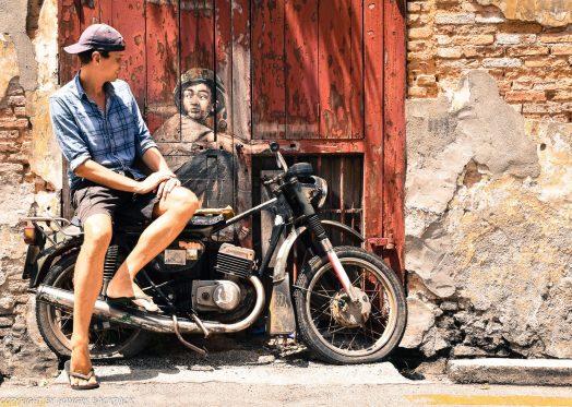 Boy on motorcycle street art Penang