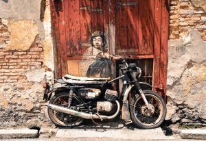 Boy on motorcycle street art mural Penang