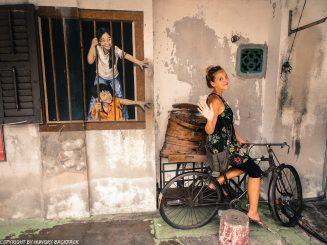 children behind window bao street art Penang