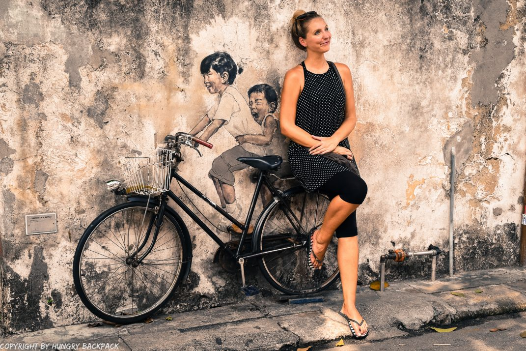 Children on bicycle famous street art mural Penang