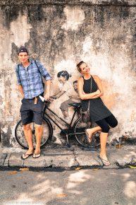 children on bicycle street art Penang