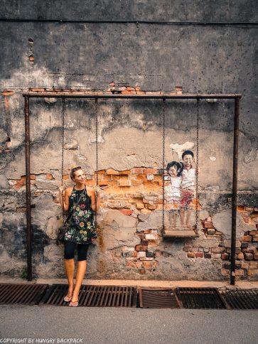 children on swing street art Penang