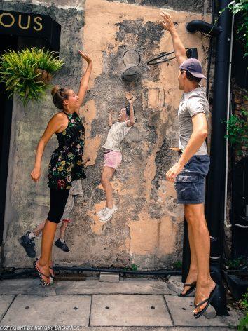 children playing basketball street art Penang