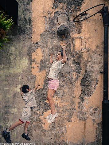 children playing basketball street art mural Penang