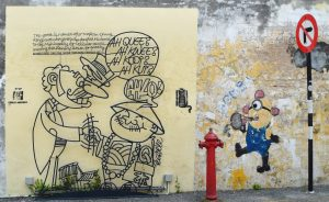 iron sculpture next to Minion Penang street art
