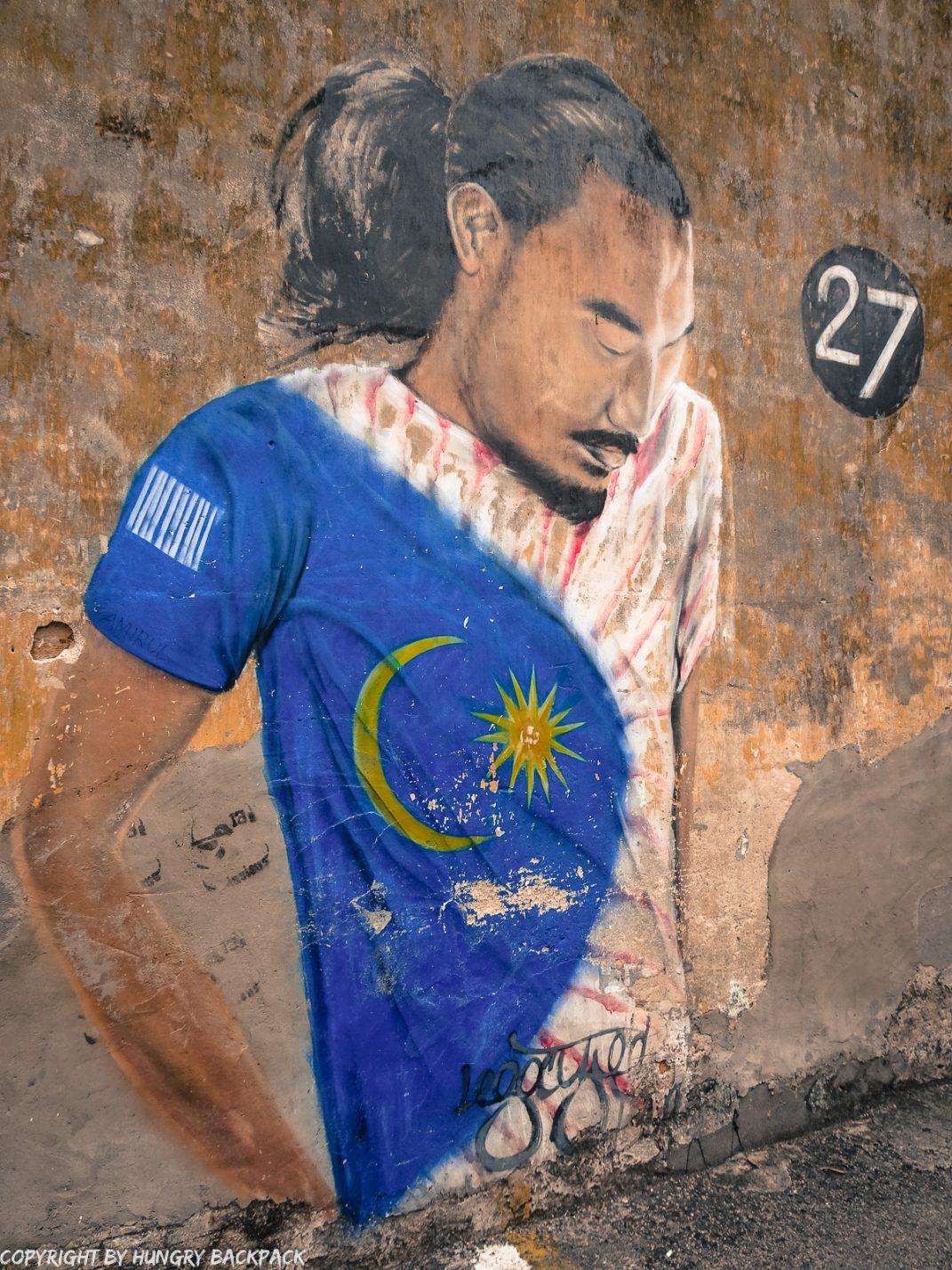 man with flag_street art mural Penang