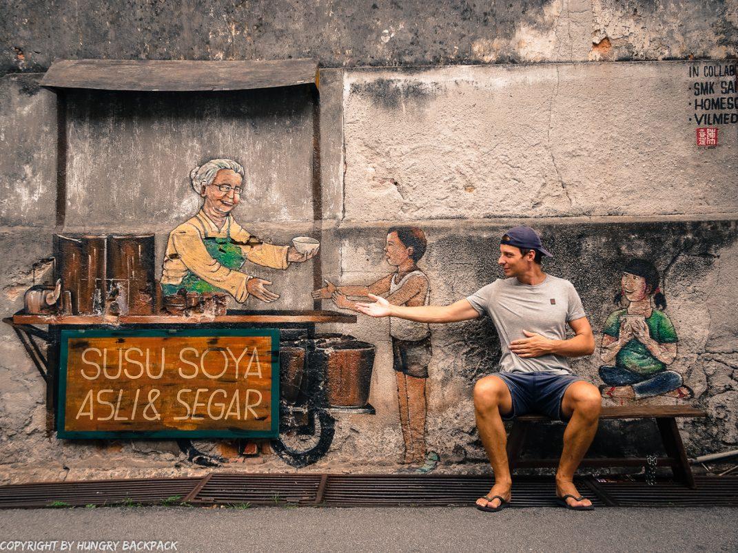 queuing for soya street art mural Penang