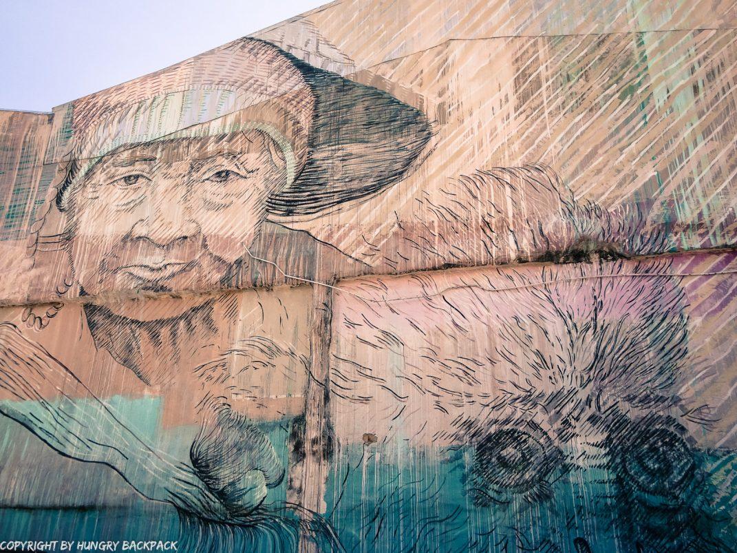 woman with monkey street art mural Penang