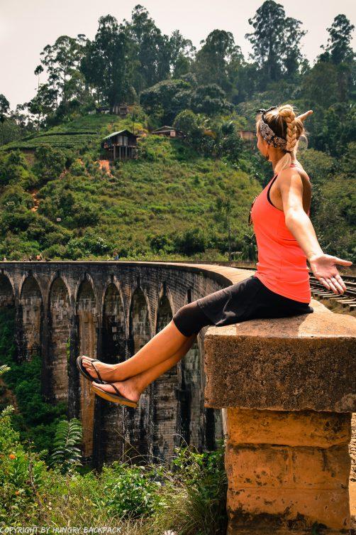 Ella hike_nine arch bridge_sitting on bridge
