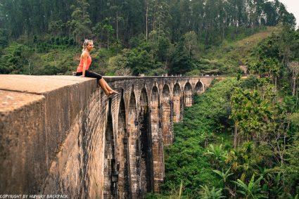 Ella hike_nine arch bridge_sitting on edge of bridge