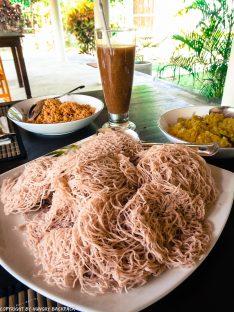 Sri Lankan breakfast - string hopper, dahl curry and woodapple juice