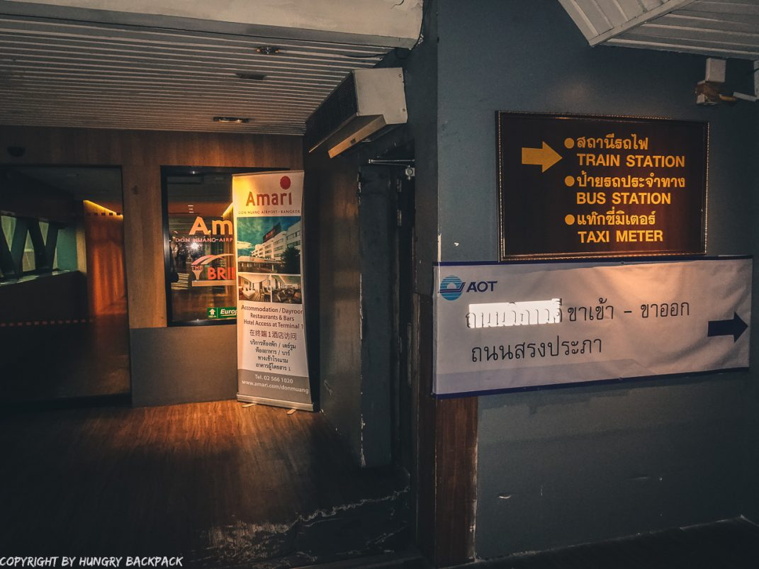 Don Mueang Airport to Bangkok City by train_door leading out to footpath from airport to train station