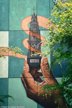 Porto street art_Trinidade_Mr Dheo holding Clerigos Tower
