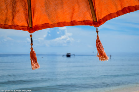 Gili Trawangan on year after earthquake_beautiful beach with umbrella close up