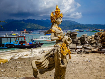 Gili Trawangan on year after earthquake_construction work at beach with statue