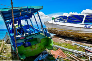 Gili Trawangan on year after earthquake_damaged tour boats at beach