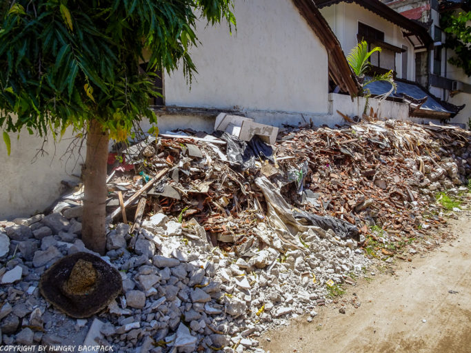 ili Trawangan on year after earthquake_pile of depris and rubble of collapsed buildings