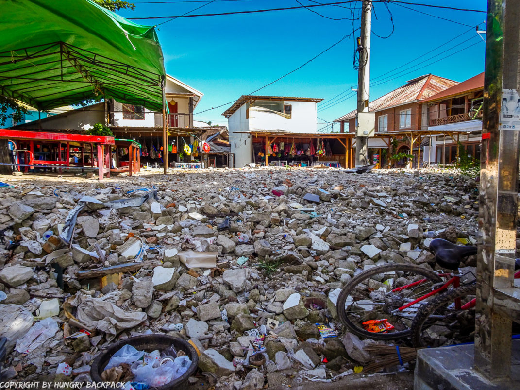 Gili Trawangan on year after earthquake_square of debris of collapsed building in center of town